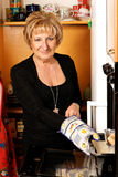 Mature italian woman. Cooking. Natural image royalty free stock photography