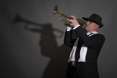 Mature Jazz man playing a trumpet Royalty Free Stock Photography