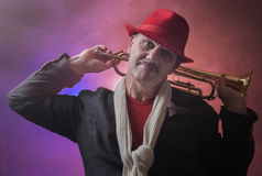 Mature Jazz man with a trumpet. Taken on a blue and purple background Stock Photography