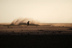 Mature Jogger. Running on beach at sunset along Cape Town beach Royalty Free Stock Photography