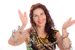 Mature lady breaking chains. Classy mature woman breaking chains isolated on white background Royalty Free Stock Photography
