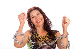 Mature lady breaking chains. Classy mature woman breaking chains isolated on white background Stock Images