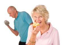 Mature lady cheating on diet Royalty Free Stock Photography