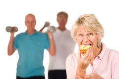 Mature lady cheating on diet Stock Images