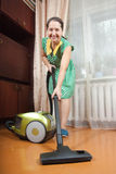 Mature lady in cleaning   room Royalty Free Stock Photos