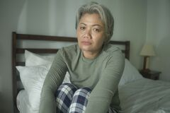 Free Mature Lady Crisis - Middle Aged Woman With Grey Hair Sad And Depressed In Bed Feeling Frustrated And Lonely Thinking About Aging Royalty Free Stock Image - 177939296