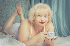 Mature lady with cup of tea Stock Images