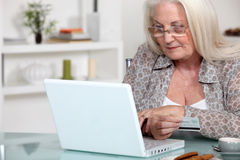 Lady doing online shopping. Stock Photo