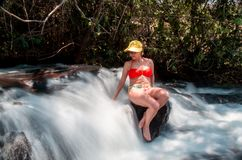 Lady Enjoying the Waterfall. Mature Lady Forty Plus Enjoying a Beautiful Waterfall Royalty Free Stock Photography