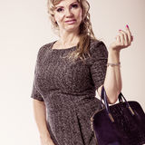 Mature lady with handbag. Stock Image