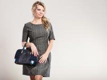 Mature lady with handbag. Royalty Free Stock Image