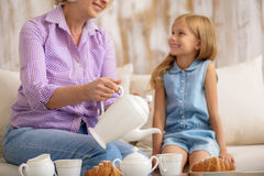 Mature lady having breakfast with her grandchild Royalty Free Stock Images
