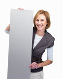 Mature lady holding blank billboard Stock Photography