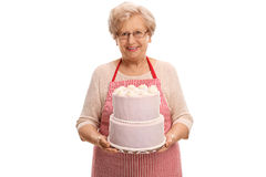 Mature lady holding a cake Royalty Free Stock Photography