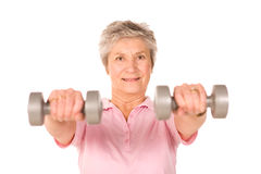 Mature lady lifting weights. During gym workout stock images