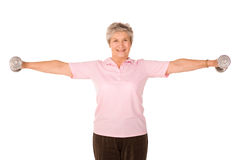 Mature lady lifting weights Stock Photo