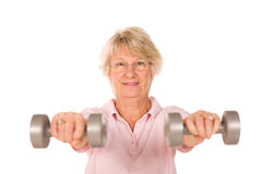 Mature lady lifting weights Stock Image