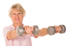 Mature lady lifting weights. During gym workout royalty free stock photo
