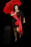 Mature lady marching with red umbrella Royalty Free Stock Photos