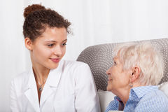 Mature lady and nurse smiling together Stock Photo