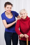 Mature lady and a nurse standing Royalty Free Stock Photos