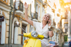 Mature lady with phone smiling. royalty free stock image
