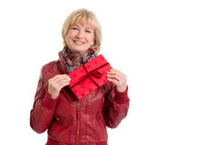 Mature lady is pleased with a gift - isolated on white Royalty Free Stock Images