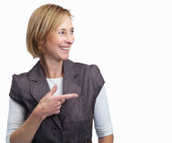 Mature lady pointing at something interesting Stock Photography