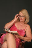 Mature lady reading Royalty Free Stock Images