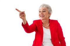 Mature lady shows something - Stock Photo. Senior businesswoman isolated in white with a blue jacket Royalty Free Stock Images