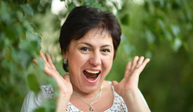 Mature lady surprised at summer Royalty Free Stock Photography