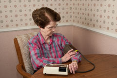 Mature lady taking blood pressure Stock Photos
