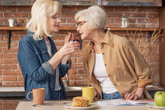 Mature lady taking care of her friend health Royalty Free Stock Photography