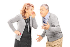 Mature lady whispering a secret to man Stock Image
