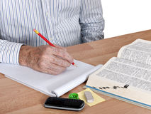 Mature language student with dictionary royalty free stock photo
