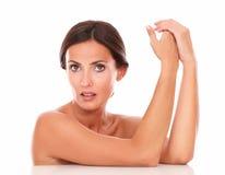 Mature latin woman touching her hands Stock Photos