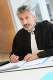 Mature lawyer working at his office Stock Images