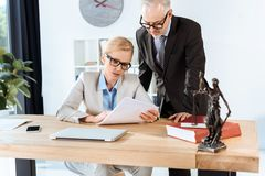 Mature lawyers with paperwork Royalty Free Stock Photography