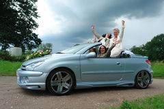 Mature lesbian couple posing after marriage. Mature lesbian couple posing in car after official same-sex marriage. This type of marriage is fully legal in Royalty Free Stock Images