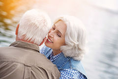 Mature loving couple has romantic date in park Stock Photography