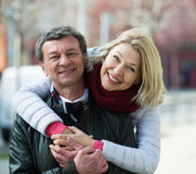 Mature loving couple in spring park Stock Photos