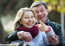 Mature loving couple in spring park Stock Photography