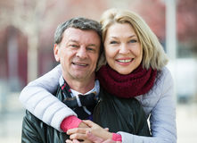 Mature loving couple in spring park Stock Image