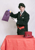 Mature magician with magic tricks Stock Images