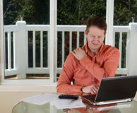 Mature main in pain while working from home office stock image