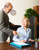 Mature male accountant  paying salary in cash Royalty Free Stock Photography