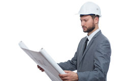 Mature male architect with a blueprint stock photography
