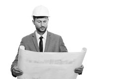 Mature male architect with a blueprint Stock Photos