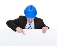 Mature Male Architect Holding Billboard Royalty Free Stock Image