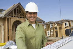 Mature Male Architect Wearing Hardhat Royalty Free Stock Image